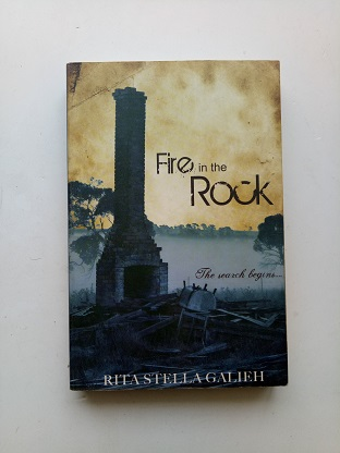 Fire In The Rock Used Books